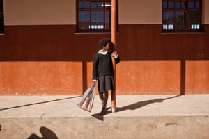 Eastern Cape Schools: A young school girl at Ntapane Junior Secondary School carries her lunch