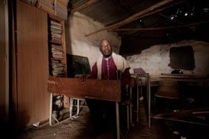 Eastern Cape Schools: Archbishop Makgoba, sitting in a mud classroom at Samson