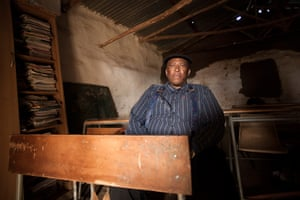 Eastern Cape Schools: Renowned writer and playright, Zakes Mda sits at one of the desks