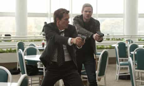 The Following: Kevin Bacon as Ryan Hardy and Shawn Ashmore as Agent Weston.