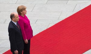 Letta welcomed with military honors in Berlin. Photograph: AP Photo/Gero Breloer