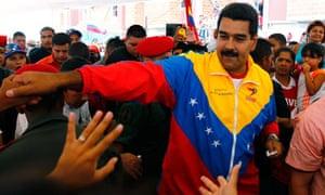 Nicolas Maduro greets supporters in Caracas