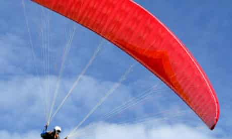 Colourful parachute in blue sky
