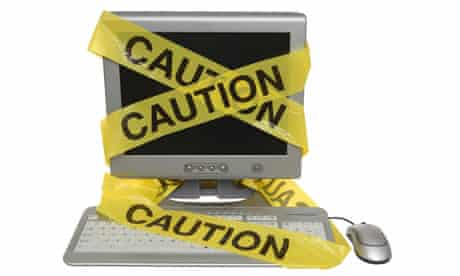 Internet privacy: Caution tape on computer