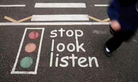 Stop, look, listen sign on road