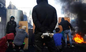 A Palestinian protester during clashes with Israeli soldiers at funeral of Maysara Abu Hamdiyeh