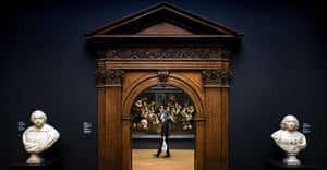 Rijksmuseum: A visitor walks by a painting during press-viewing day