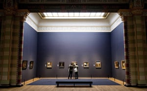 Rijksmuseum: Visitors look at paintings during the press-viewing day