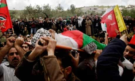 Palestinian mourners carry the body of Amer Nasser during his funeral in Anabta, West Bank