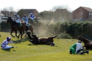 Dangers of Aintree: Competitors fall at Beechers Brook