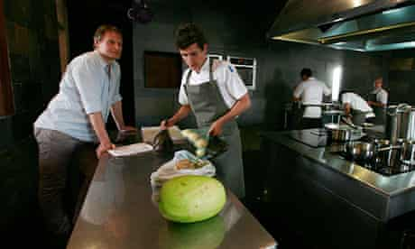 Noma chef Claus Meyer watches young chefs at work in the kitchen at Gustu restaurant in La Paz