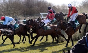 Horses take on the Becher's Brook jump