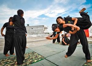 Women from the Red Brigade take part in a martial arts training session