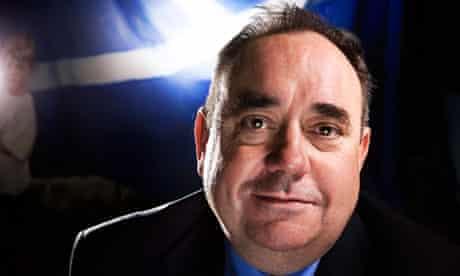 Alex Salmond with Scottish flag behind him