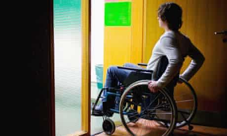 Disabled man in wheelchair in doorway