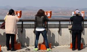 South Korean tourists look towards the North