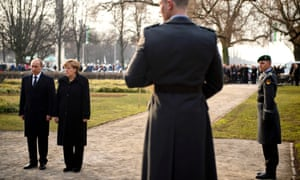 German Chancellor Angela Merkel and Russian President Vladimir Putin attend a wreath-laying ceremony at the Cemetery of Honour on the north bank of the Maschsee Lake in Hannover, Germany. Buried in this cemetery are forced labourers from all over Europe, who were murdered by the Nazi regime near the end of WWII.