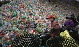 Workers sort waste plastic bottles at the Xiejiacun waste collection market in the Changping district of Beijing. China will spend 100 billion yuan ($16 billion) over three years to deal with Beijing's pollution, according to an official newspaper, China Daily.