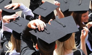 Students from behind with their graduation hats on