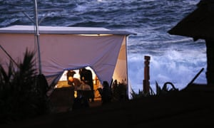 A forensic team prepares for the exhumation of the remains of Chilean poet Pablo Neruda who died in 1973 under a tent over his tomb at the house-museum Isla Negra, near to El Quisco, west of Santiago de Chile. The remains will be examined to establish the cause of Neruda's death.