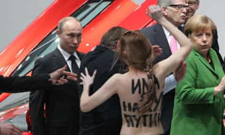 Russian president Vladimir Putin, left, is accosted by a Femen activist in Hanover