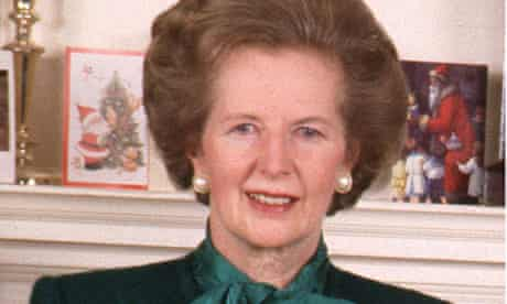 Margaret Thatcher posing for a Christmas card at 10 Downing Street in 1988.