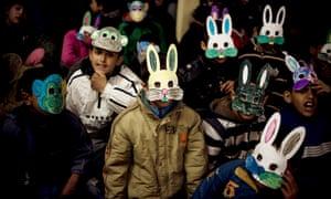 Roma children wear masks during the International Roma Day in Pristina, Kosovo.