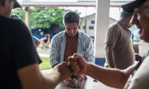 Brazilian truck drivers play cards at a truck parking lot near the border with Bolivia in Corumba, Matto Grosso do Sul state, Brazil.