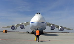 A crew member walks in front of the airplane during the 30th anniversary of the maiden flight of the world's largest serially manufactured cargo airplane Antonov An-124 Ruslan in Leipzig, central Germany. The first flight took place in December 1982 and the first exposure to the West followed in 1985 at the Paris Air Show.