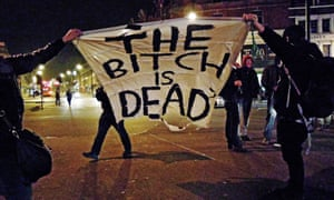 People pictured holding a banner bearing the message: 'The Bitch Is Dead' as they form a temporary roadblock in Brixton. They were celebrating the death of Lady Thatcher.