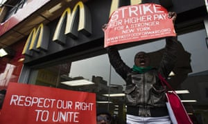 Fast food workers protesting low wages in Harlem, New York, April 2013