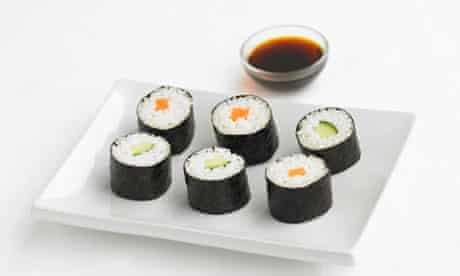 Sushi with soy sauce.