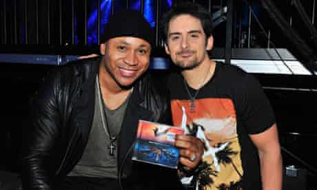 LL Cool J and Brad Paisley, celebrating their duet 'Accidental Racist'