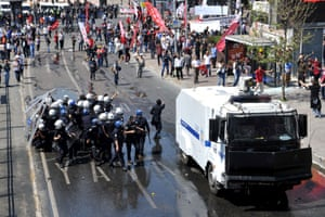 Riot police and protestros clash at a May Day demonstration on May 1, 2013, in Istanbul.  Several people were injured on Wednesday as Turkish riot police used water canon and tear gas to disperse hundreds of protesters who defied a May Day ban on demonstrations in a central part of Istanbul.