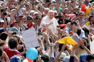 Pope Francis waves to faithful as he arrives in St. Peter's Square for his Weekly Audience on May 1, 2013 in Vatican City, Vatican.