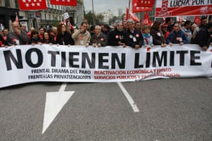 """General Workers Union (UGT) leader Candido Mendez and Ignacio Fernandez Toxo, leader of Comisiones Obreras (CCOO) march among other union members  during a Labour Day demonstration in central Madrid May 1, 2013. The banner reads """"They don't have limit"""". REUTERS/Juan Medina(SPAIN - Tags: CIVIL UNREST BUSINESS EMPLOYMENT POLITICS) :rel:d:bm:GF2E95110T201"""