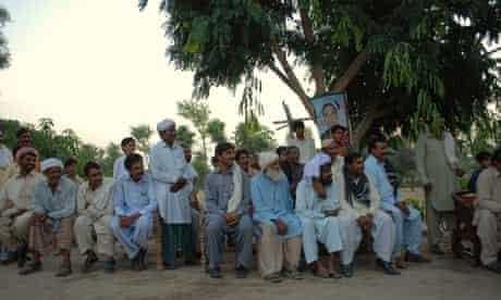 Supporters listen to a speech by  Makhdoum Shahabuddin Makhdoum