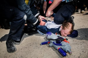 An unidentified man is arrested for shooting  a water gun towards the Danish Prime Minister Helle Thorning-Schmidt during her speech, Wednesday May 1, 2013 at Tangkroen in Aarhus, Denmark. Thorning-Schmidt met with strong protests during her May Day speech.