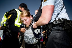 A unidentified man is arrested for shooting  a water gun towards the Danish Prime Minister Helle Thorning-Schmidt, during her speech, Wednesday May 1 2013 at Tangkroen in Aarhus, Denmark. Thorning-Schmidt was met with strong protests during her May Day speech.