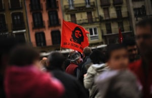A flag with the face of Che Guevara  reading, ''To the Victory. Always'', waves during the celebration of the day of workers, May Day, in Pamplona, northern Spain on Wednesday, May 1, 2013.