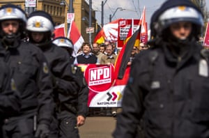 Supporters of the far-right NPD political party wave flags as they demonstrate in Schoeneweide district on May Day on May 1, 2013 in Berlin, Germany. Approximately 500 NPD supporters took part in the demonstration, and several thousand counter-protesters heckled them and attempted block the NPD demonstration route.