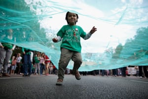 24 hours in picture: A child runs under a banner as students protest in Spain