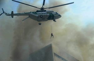 24 hours in picture: A Pakistani army helicopter rescues a man