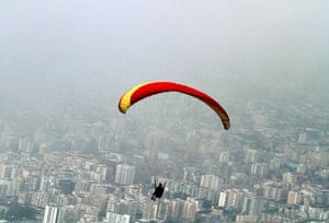 24 hours in picture: A paraglider flies over the Albanian coastal town of Vlora