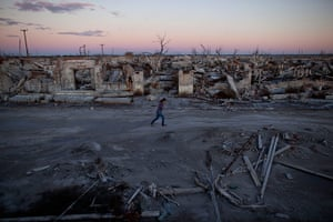 24 hours in picture: A resident walks through Epecuen, a village that once was submerged
