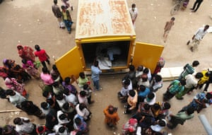 24 hours in pictures: Relatives gather as rescue worker unload dead bodies