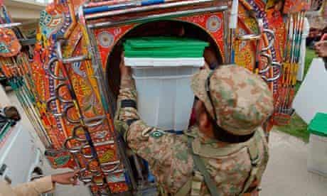 A Pakistani soldier loads ballot boxes into a van in Rawalpindi