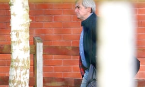 Chris Huhne carries his bags after his release from Leyhill Prison, in Wotton-under-Edge, south west England this morning.