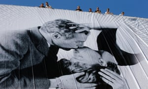 Preparations for the 66th Cannes film festival are under way as a poster of Hollywood god Paul Newman and his wife Joanne Woodward is unfurled.