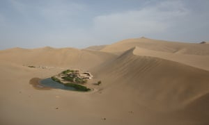 Location, location, location … The Yueyaquan crescent lake in Dunhuang, in China's north-western Gansu province. It was formerly a silk route hub and centre for trade between China and the west, and now relies heavily on tourism.